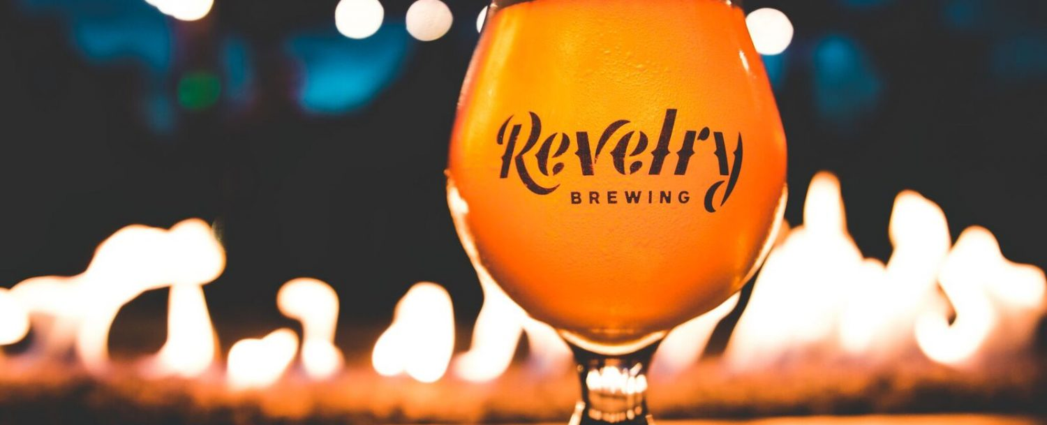 Revelry Brewing glass of beer on the bar top
