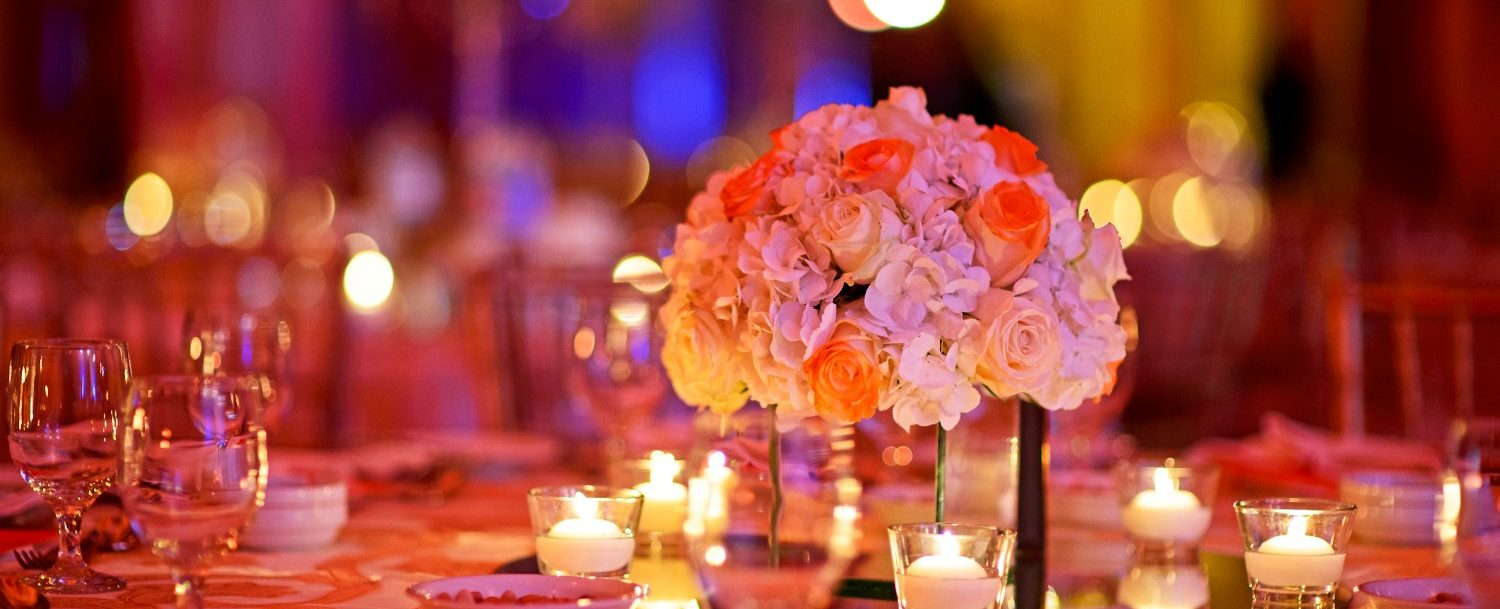 table with centerpiece and place settings in the ballroom at the charleston gaillard center
