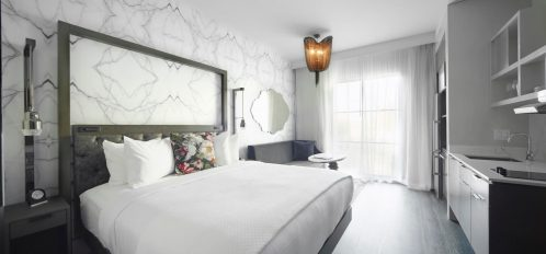 king studio suite room beautiful plush linens on white bed
