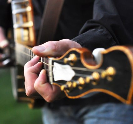 jazz guitar player playing guitar